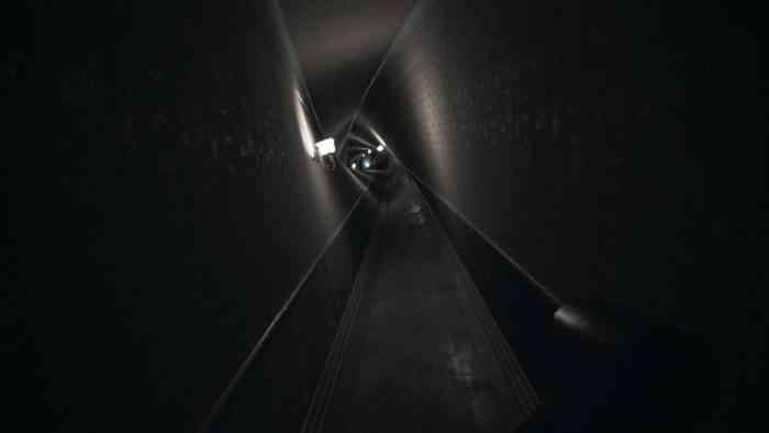 A screenshot from Visage showing a hallway which gradually twists and spirals as it fades into the distance.