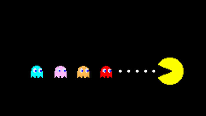 Pac-Man eating dots and moving toward the ghosts.